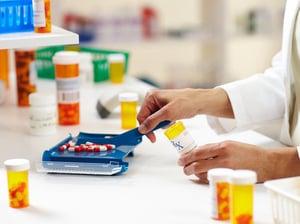 pharmacist dispensing pills web
